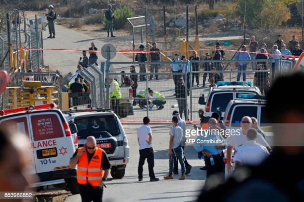 TOPSHOT Israeli security forces and emergency teams gather at the scene of an attack at the entrance to the West Bank settlement of Har Adar after a...