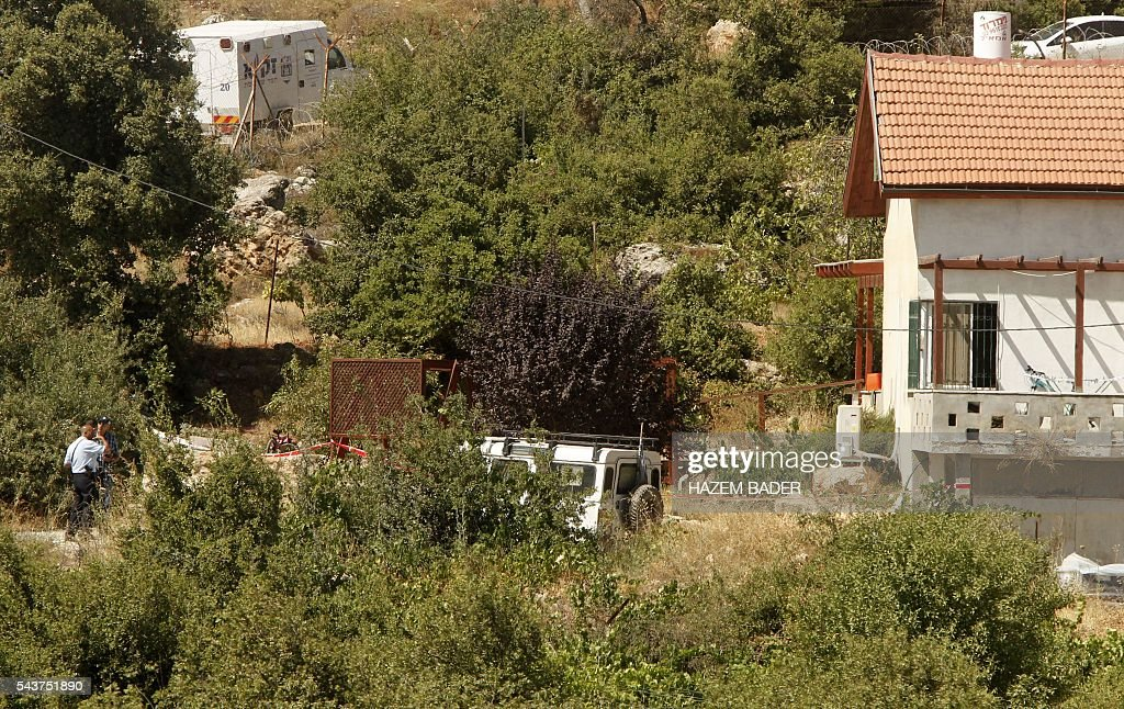 Israeli security forces and forensic inspect the area around a house in the Jewish settlement of Kiryat Arba where a 13-year-old Israeli girl was fatally stabbed in her bedroom on June 30, 2016 in the occupied West Bank near the Palestinian city of Hebron. A Palestinian attacker broke into the Jewish settlement in the occupied West Bank, fatally stabbing a teenage girl and wounding a security guard before being shot dead, the army said. BADER