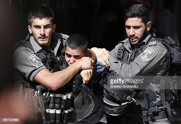 Israeli security forces arrest a Palestinian man during clashes between protesters and police after authorities limited access for Muslim worshipers...