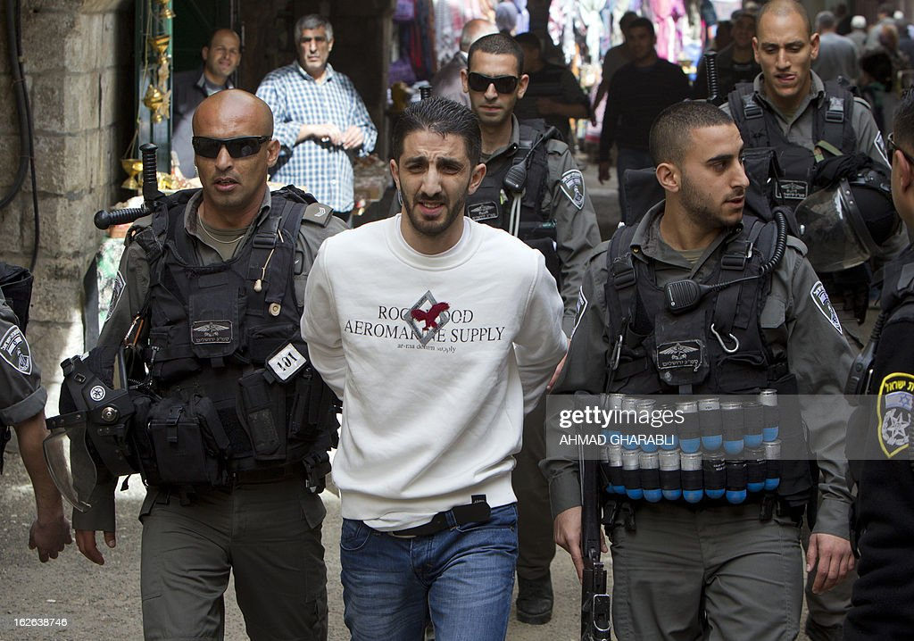 Israeli security forces arrest a Palestinian man in Jerusalem's old city, near Al-Aqsa mosque on February 25, 2013 after a group of Israeli settlers attempted to enter the compound on February 25, 2013. Palestinian president Mahmud Abbas said that Israel was deliberately seeking to stoke unrest in the occupied West Bank but that Palestinians would not be provoked.