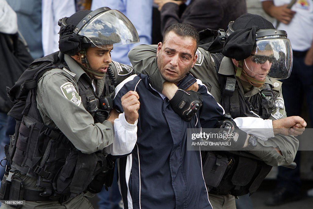 Israeli security forces arrest a Palestinian protestor as clashes broke out near Damascus gate in Jerusalem on May 15, 2013 during a rally to mark the 65th Nakba or 'catastrophe' of the Jewish state's creation in 1948, during which 760,000 Palestinians fled their homes. Thousands of Palestinians took to the streets in the West Bank and the Gaza Strip to demonstrate on Nakba Day and assert their 'right to return' to where their ancestors fled after the Israeli victory over Arab armies.