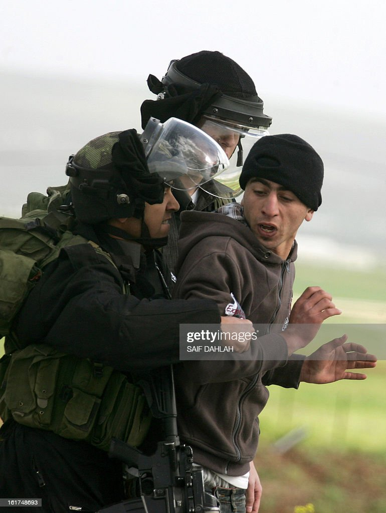 Israeli security forces arrest a Palestinian protestor during clashes at the entrance of the Jalama checkpoint, near the West Bank city of Jenin, on February 15, 2013.