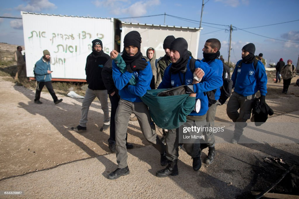 Israeli security forces arrest a settler during the evacuation of an illegal Jewish settlement on February 1, 2017 in Amona, West Bank. Israeli Security forces have started evacuating residents from the illegal outpost of Amona in the West Bank on Wednesday, after hundreds of youths streamed into the outpost to fight the evacuation.
