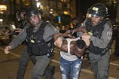 Israeli security forces arrest an Israeli man from the Ethiopian community in the coastal city of Tel Aviv on May 3 during a protest against alleged...