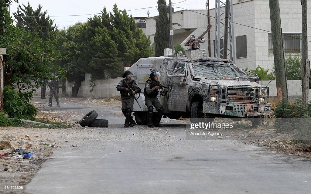 Israeli security forces attack Palestinians during the demonstration against Israeli Authority's Jewish settlement construction and separation wall in Kafr Qaddum, in Nablus West Bank on May 27, 2015.