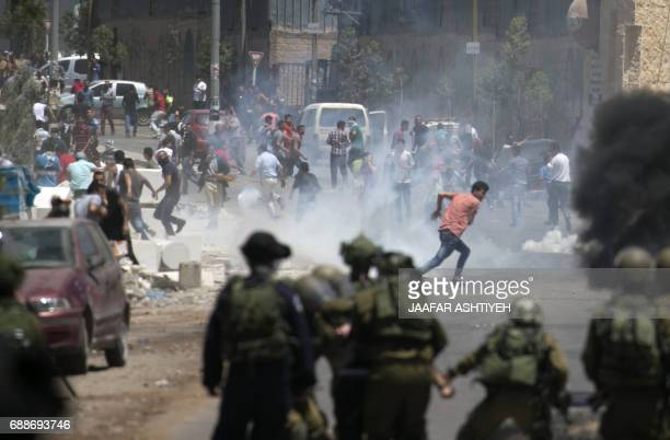 Israeli security forces clash with Palestinian demonstrators following a Friday noon prayer in solidarity with Palestinian prisoners held in Israeli...