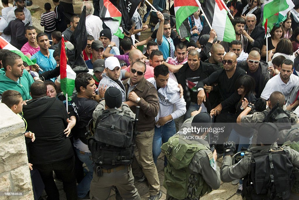 Israeli security forces clash with Palestinian protestors outside Damascus gate in Jerusalem on May 15, 2013 during a rally to mark the 65th Nakba or 'catastrophe' of the Jewish state's creation in 1948, during which 760,000 Palestinians fled their homes. Thousands of Palestinians took to the streets in the West Bank and the Gaza Strip to demonstrate on Nakba Day and assert their 'right to return' to where their ancestors fled after the Israeli victory over Arab armies. AFP PHOTO / JACK GUEZ