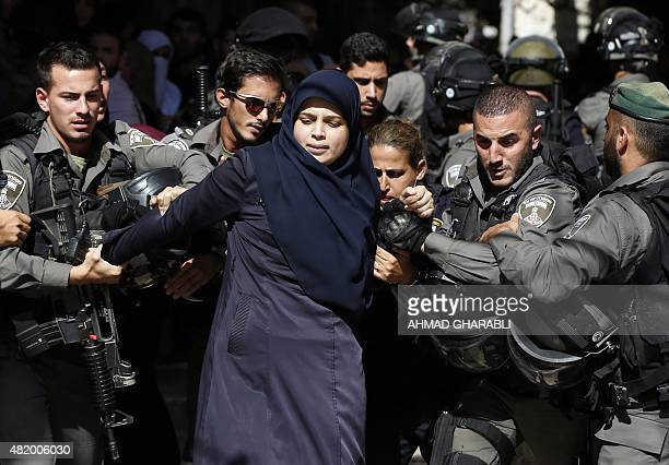 Israeli security forces detain Palestinian Dania Basem Fudail believed to belong to a group made up of Islamist women commonly referred to as...