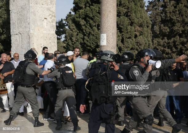 Israeli security forces disperse Palestinians who entered the Haram alSharif compound in the complex in the old city of Jerusalem on July 27 2017...