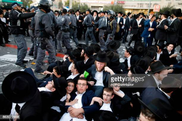 Israeli security forces disperse UltraOrthodox Jewish demonstrators during a protest against Israeli army conscription in the centre of Jerusalem on...