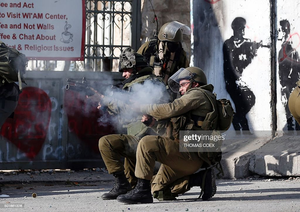 TOPSHOT Israeli security forces fire tear gas and different kinds of bullets towards Palestinian stone throwers during clashes following a...