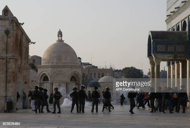 Israeli security forces fire teargas to disperse Palestinians after clashes broke out inside AlAqsa mosque's compound in Jerusalem's Old City on July...