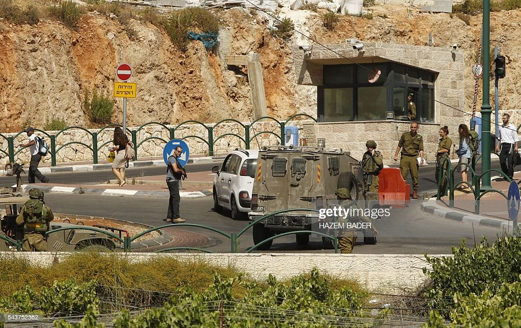 Israeli security forces gather at the Jewish settlement of Kiryat Arba where a 13-year-old Israeli girl was fatally stabbed in her bedroom on June 30, 2016 in the occupied West Bank near the Palestinian city of Hebron. A Palestinian attacker broke into the Jewish settlement in the occupied West Bank, fatally stabbing a teenage girl and wounding a security guard before being shot dead, the army said. BADER