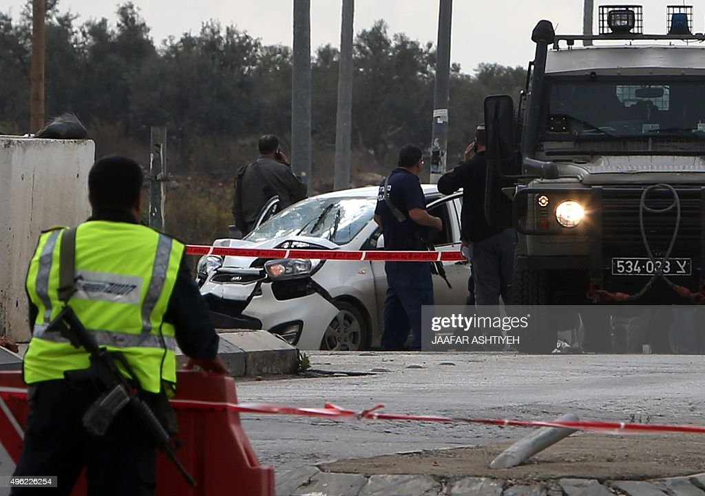 Israeli security forces gather at the scene where a Palestinian man was shot dead by security forces after ramming his car into a group of Israelis...