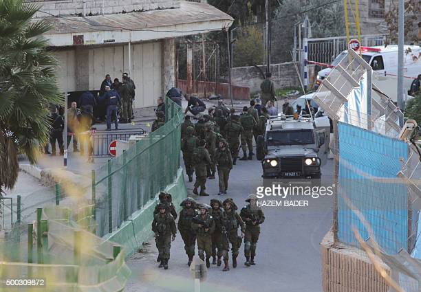 Israeli security forces gather at the site where a Palestinian stabbed an Israeli before being shot dead by security forces near the Ibrahimi mosque...