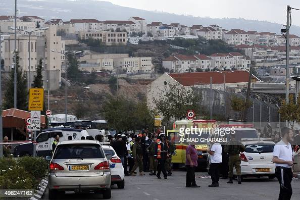 Israeli security forces gather at the site where a Palestinian woman reportedly stabbed an Israeli security guard and was then shot by him on...