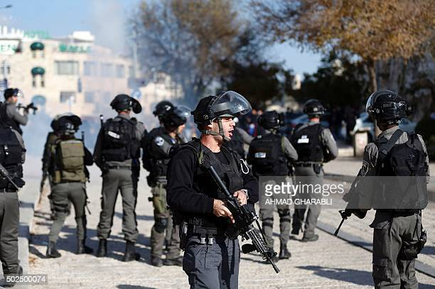 Israeli security forces hold position outside Damascus Gate in Jerusalem's old city during clashes with Palestinian protesters taking part in a...
