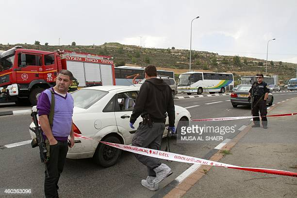 Israeli security forces inpsect the scene of an acid attack by a Palestinian hitchhiker on an Israeli family on December 12 near a checkpoint outside...