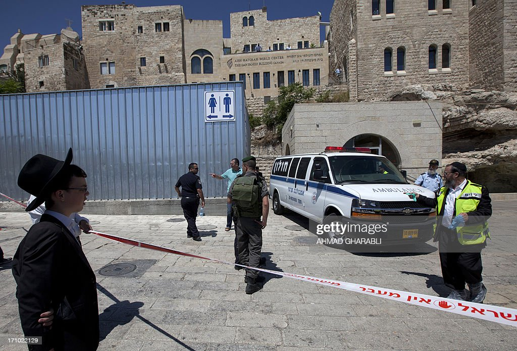 Israeli security forces inspect the area around the Wailing Wall, the holiest site where Jews can pray, in Jerusalem's Old City on June 21, 2013 after an Israeli security guard shot dead a Jewish visitor apparently mistaking him for a Palestinian militant. The shooting took place shortly before 8 am (0500 GMT) as the plaza in front of the Wall filled with worshippers for morning prayers ahead of the start of the Jewish Sabbath at sundown.