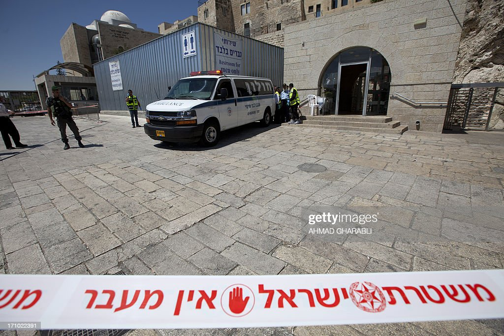 Israeli security forces inspect the area around the Wailing Wall, the holiest site where Jews can pray, in Jerusalem's Old City on June 21, 2013 after an Israeli security guard shot dead a Jewish visitor apparently mistaking him for a Palestinian militant. The shooting took place shortly before 8 am (0500 GMT) as the plaza in front of the Wall filled with worshippers for morning prayers ahead of the start of the Jewish Sabbath at sundown. AFP PHOTO / AHMAD GHARABLI