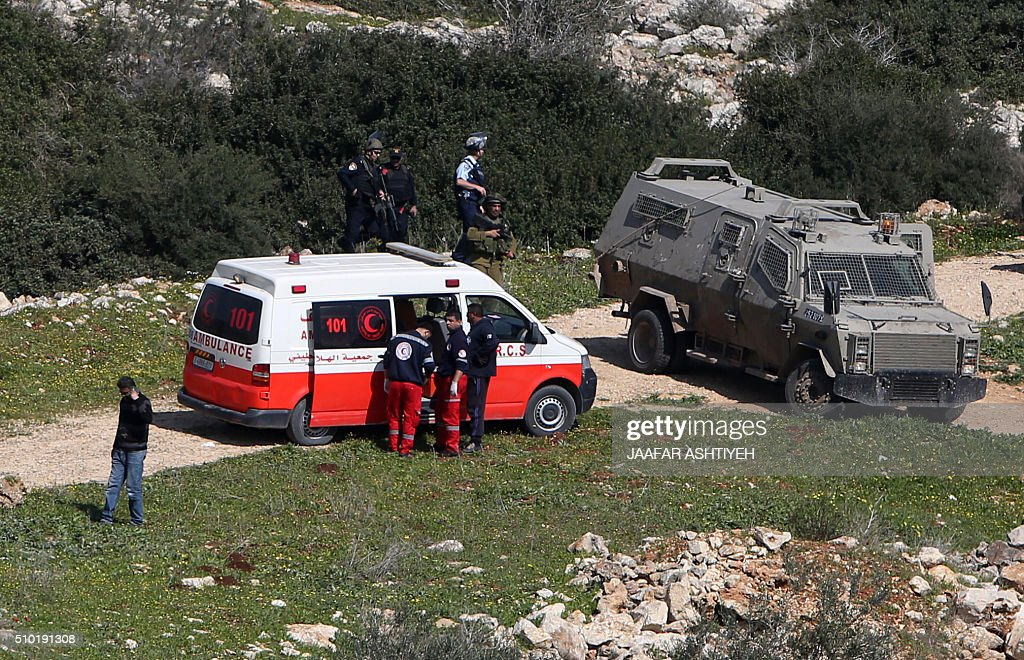 Israeli security forces inspect the area where two Palestinian teenagers were shot dead by security forces as they reported fired on Israeli soldiers on February 14, 2016 in the village of Araka, West of Jenin in the Israeli occupied West Bank. An Israeli army statement said the two teenagers attacked an Israeli patrol west of the city of Jenin with rocks before firing on soldiers with a rifle. 'The force responded to the shooting and fired towards the attackers, resulting in their deaths,' it said. The Palestinian health ministry named those killed as Nihad Waked and Fuad Waked, both 15 years old. They were not thought to be closely related. ASHTIYEH