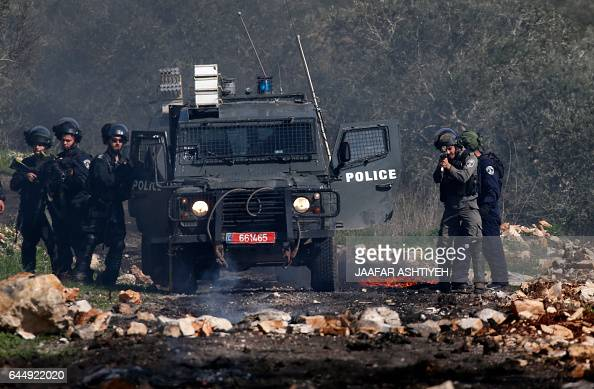 Israeli security forces keep position during clashes with Palestinian protestors following a weekly demonstration against the expropriation of...