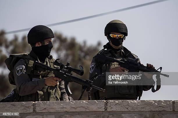 Israeli security forces look on during a noon Friday prayer outside Ras Al Amud neighbourhood on October 16 2015 in Jerusalem Israel As violence...