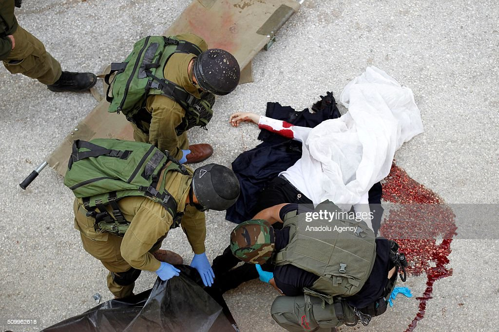 Israeli security forces make crime scene investigation after Israeli soldiers shot a Palestinian girl who allegedly attempted knife attack in Hebron, West Bank on February 13, 2016.
