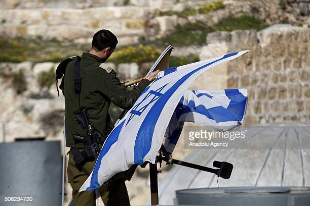 Israeli security forces remove the flags of Israel from the Palestinian properties that illegally seized by Jewish settlers in Hebron West Bank on...