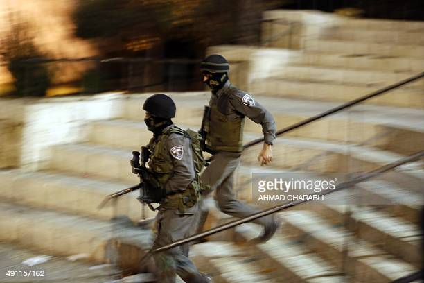 Israeli security forces run next to the site where a Palestinian carried out a stabbing attack in the old city of Jerusalem on October 3 2015 A...