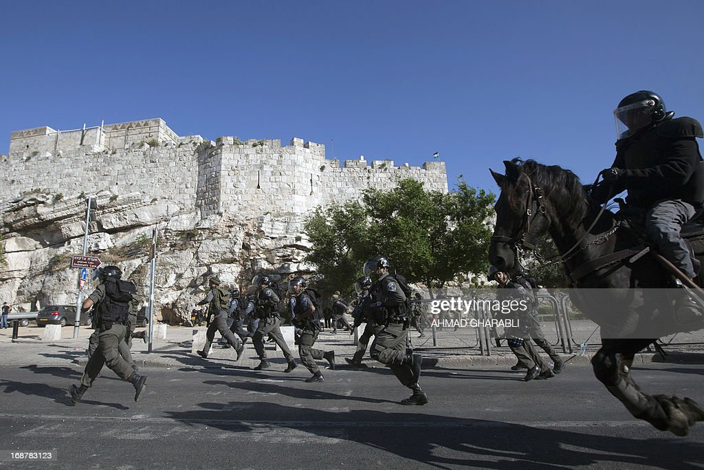 Israeli security forces run to disperse protestors as clashes broke out near Damascus gate in Jerusalem on May 15, 2013 during a rally to mark the 65th Nakba or 'catastrophe' of the Jewish state's creation in 1948, during which 760,000 Palestinians fled their homes. Thousands of Palestinians took to the streets in the West Bank and the Gaza Strip to demonstrate on Nakba Day and assert their 'right to return' to where their ancestors fled after the Israeli victory over Arab armies.