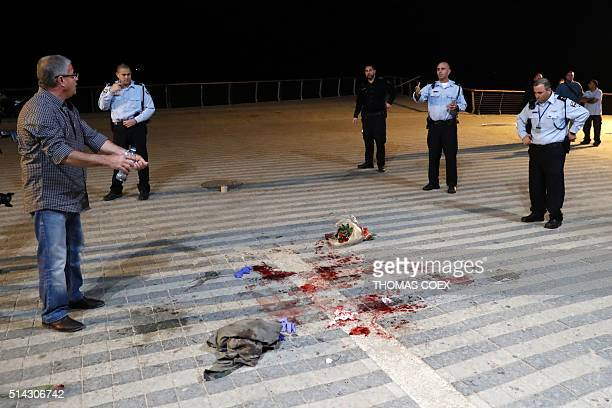 Israeli security forces stand at the scene of a stabbing attack on March 8 2016 in the neighbourhood of Jaffa in the Israeli city of Tel Aviv as US...