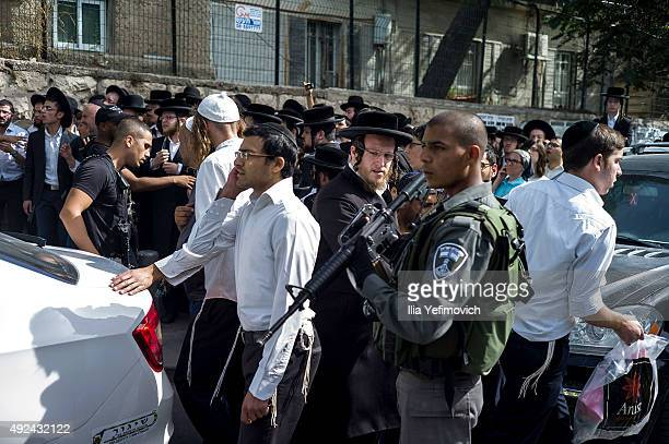 Israeli security forces stand attend the scene of a stabbing attack on October 13 2015 in Jerusalem Israel Tensions in the area continue to run high...