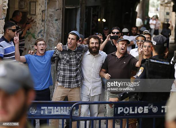 Israeli security forces stand guard as a group of Jewish youths leave after visiting the alAqsa mosque compound the third holiest site in Islam and...