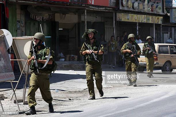 Israeli security forces stand guard as Palestinians stage a protest against ongoing Israeli military operations on Gaza in Nablus West Bank on July...