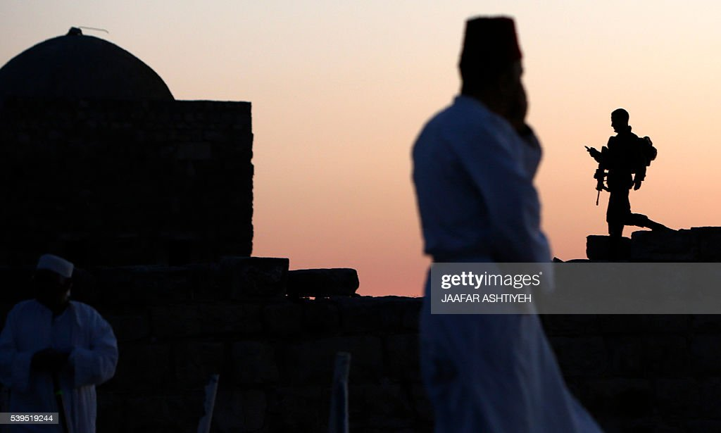 Israeli security forces stand guard as Samaritan worshipers gather to pray on top of Mount Gerizim near the northern West Bank city of Nablus to...