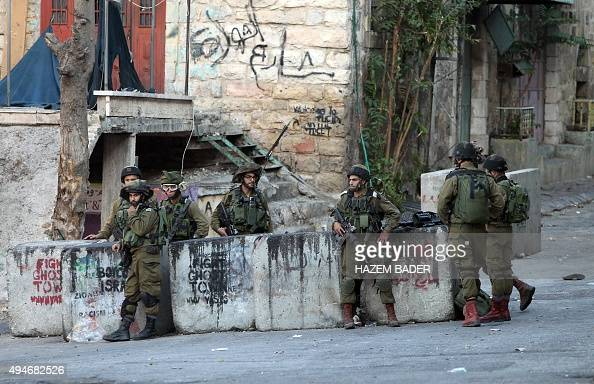 Israeli security forces stand guard close to the site where a Palestinian attempted to stab an Israeli soldier before being shot dead in the occupied...
