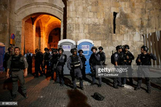 Israeli security forces stand guard outside the Lion's Gate a main entrance to the AlAqsa mosque compound in Jerusalem's Old City on July 20 as...