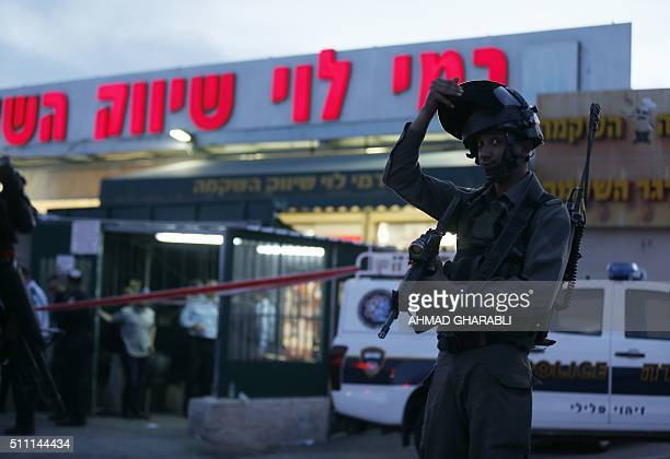 Israeli security forces stand guard outside the Rami Levi supermarket in Shaar Binyamin near Ramallah in the occupied West Bank after two...