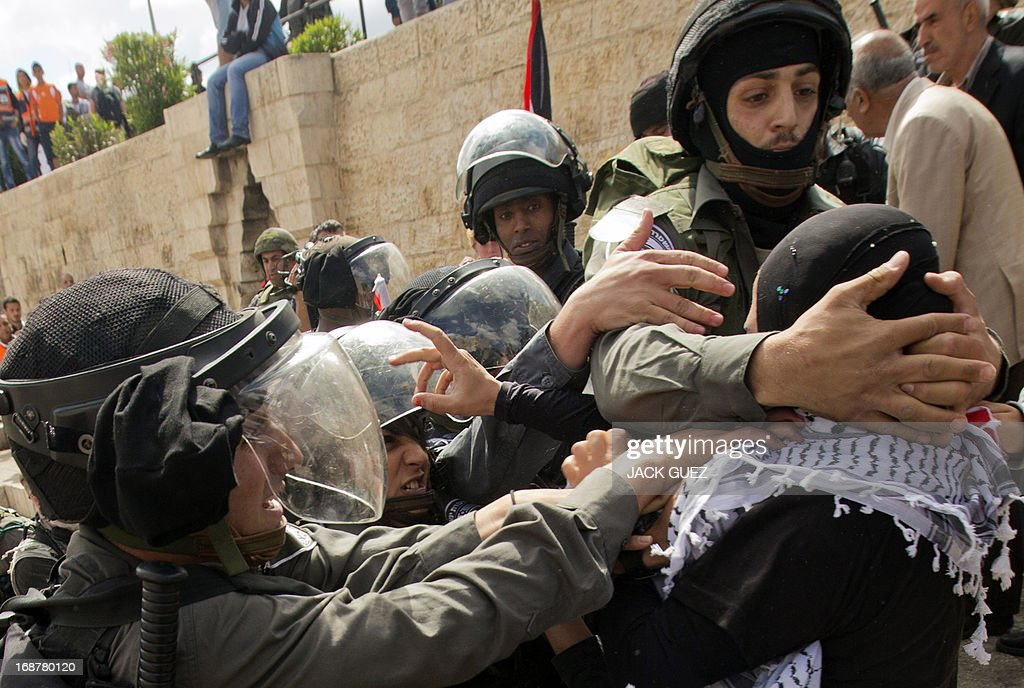 Israeli security forces try to arrest a Palestinian protestor as clashes broke out outside Damascus gate in Jerusalem on May 15, 2013 during a rally to mark the 65th Nakba or 'catastrophe' of the Jewish state's creation in 1948, during which 760,000 Palestinians fled their homes. Thousands of Palestinians took to the streets in the West Bank and the Gaza Strip to demonstrate on Nakba Day and assert their 'right to return' to where their ancestors fled after the Israeli victory over Arab armies.