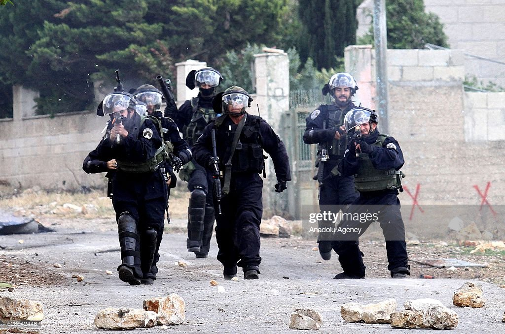 Israeli security forces use tear gas as a group of Palestinians protest against the land expropriations by Israeli government at the village of Kafr Qaddum in the city of Nablus on the West Bank on May 6, 2016.