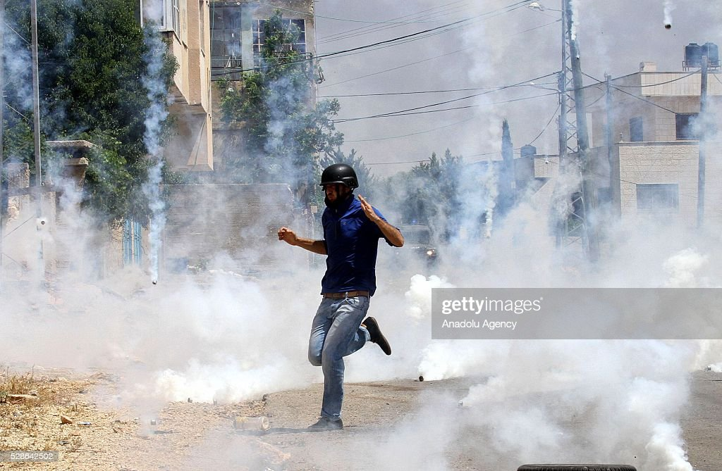 Israeli security forces use tear gas as a group of Palestinians protest the land expropriations by Israeli government at the village of Kafr Qaddum in the city of Nablus on the West Bank on May 6, 2016.