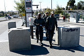 Israeli security officials walk past concrete blocks placed at the entrance to Ammunition Hill train station on November 06 2014 in Jerusalem Israel...