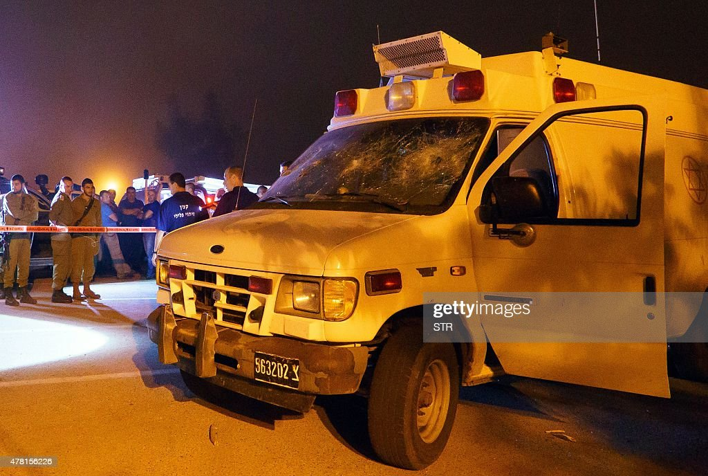 OUT== Israeli security personnel check an Israeli military ambulance which was attacked by Israeli Druze in the Israeli settlement of Neve Ativ near...