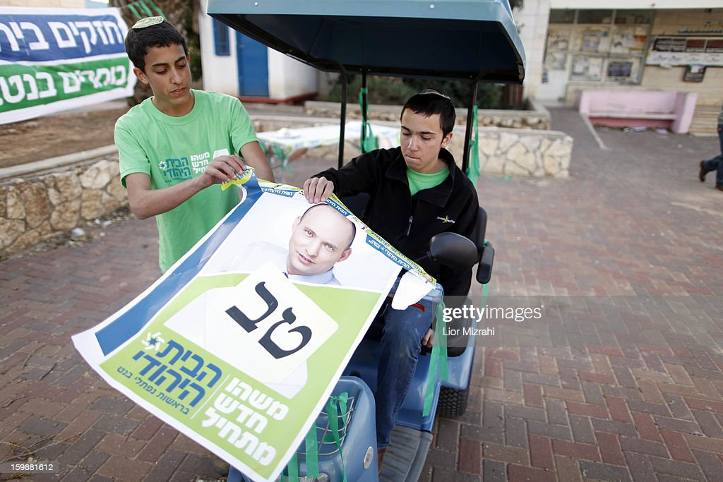 Israeli seporters of Naftali Bennett , head of HaBayit HaYehudi outside a polling station on election day on January 22, 2013 in the Jewish settelment of Ofra, West Bank. Israel's general election voting has begun today as polls show Netanyahu is expected to return to office with a narrow majority.