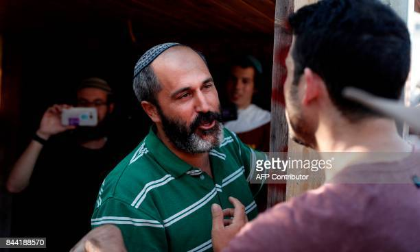 Israeli settler Arieh King argues with a Peace Now member as Palestinians and leftwing activists demonstrate on September 8 2017 outside a...