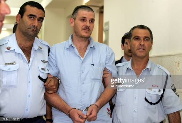 Israeli settler Asher Weissgan is escorted by policemen into the courtroom at the Jerusalem District Court 27 September 2006 Jerusalem District Court...