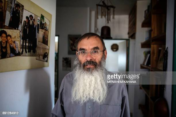 Israeli settler Gabriel BenYitzhak poses for a photo in his home at the Tel Rumeida Jewish settlement located inside the divided West Bank city of...
