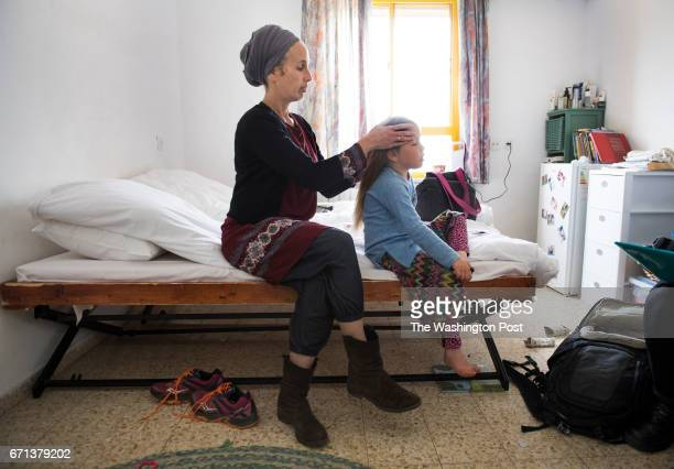 Israeli settler Tamar Nizri 38 with 5yearold daughter Noa with her family of ten have been staying in cramped quarters at a hostel in Ofra West Bank...