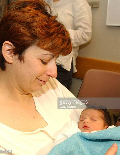 Israeli settler Tamara Liftschitz holds her as yet unnamed newborn daughter for the first time in Jerusalems Hadassah hospital February 27 2002 two...